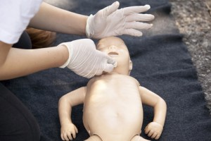 http://www.dreamstime.com/stock-photography-first-aid-training-infant-dummy-image31457332